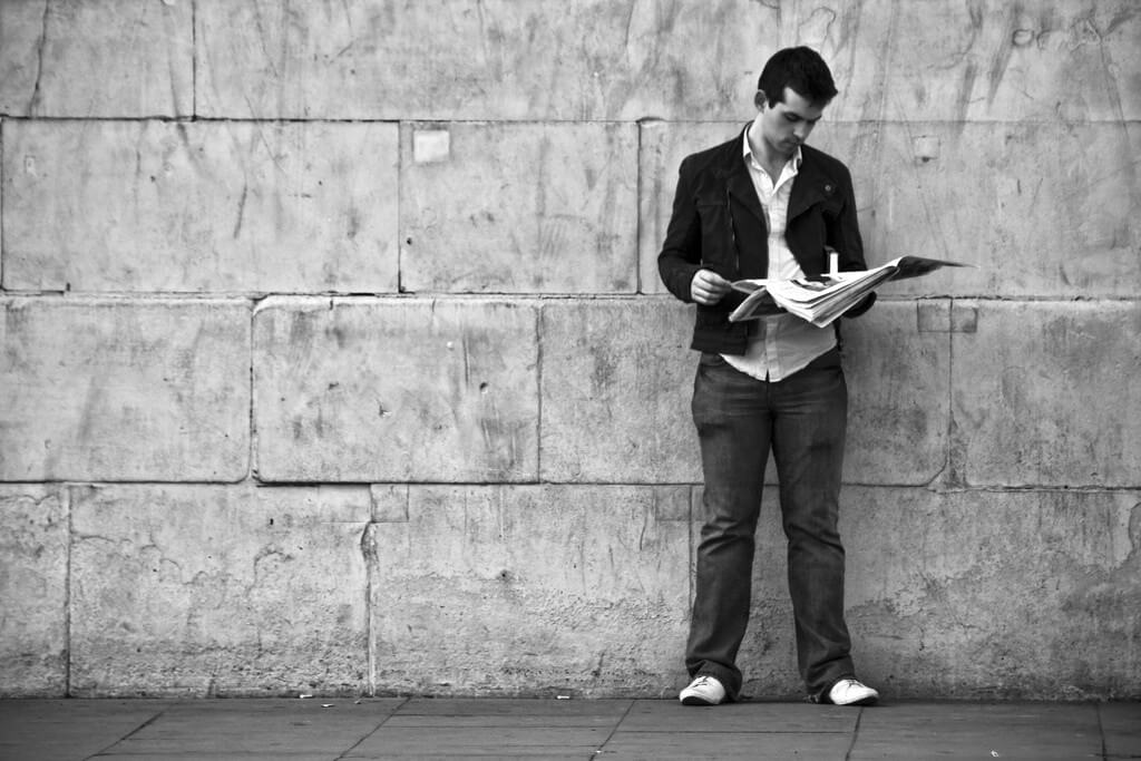 Reading A Newspaper By A Wall, by Garry Knight. Reproduced with permission.