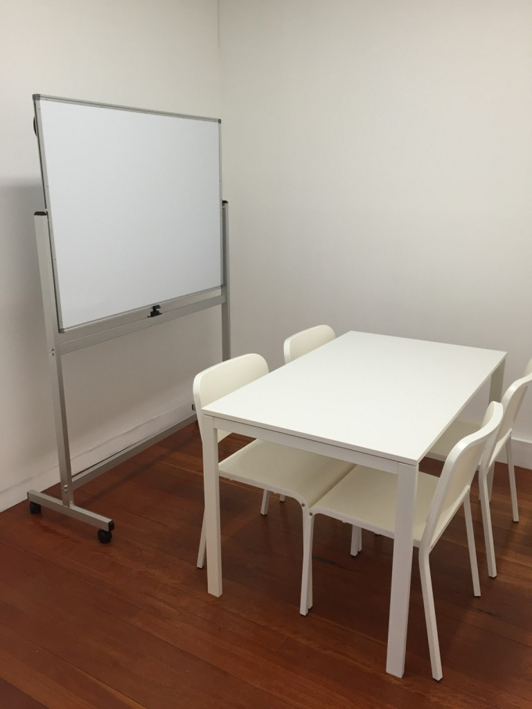 Our small Meeting Room, including whiteboard and pinboard for brainstorming!