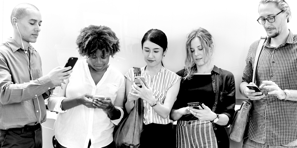 Peple looking at their mobile phones.